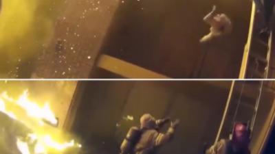 Un pompier rattrape au vol un enfant jeté d'un immeuble en feu