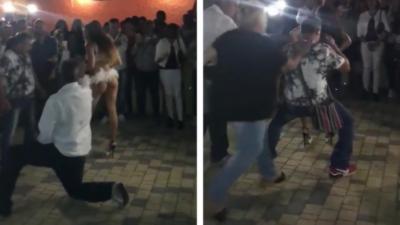 Un homme danse avec une danseuse sexy et se fait griller par sa femme