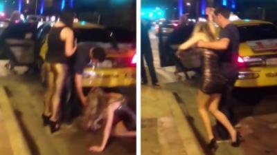 Deux filles tellement ivres qu'elles n'arrivent pas à monter dans un taxi
