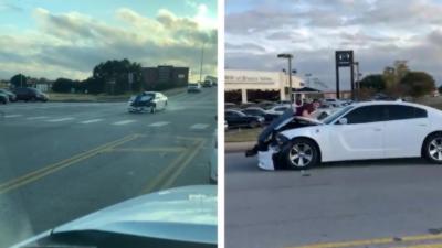Après un accident, un homme prend la fuite avec un automobiliste sur son capot