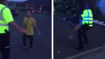 Un policier fait une prise de catch pour calmer un homme ivre et agressif